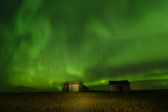 aurora borealis, northern lights, prairie, harvest, crops, granary, farm buildings, green glow, night photography, Dan Jurak, long exposure,